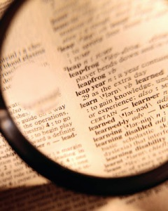 Magnifying Glass over Dictionary