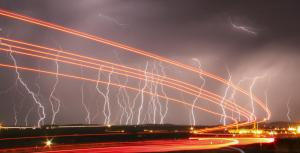 Mass lightning bolts light up night skies by the Daggett airport from monsoon storms passing over the high deserts early Wednesday, north of Barstow, California July 1, 2015. Picture taken using long exposure. REUTERS/Gene Blevins - RTX1ILBY