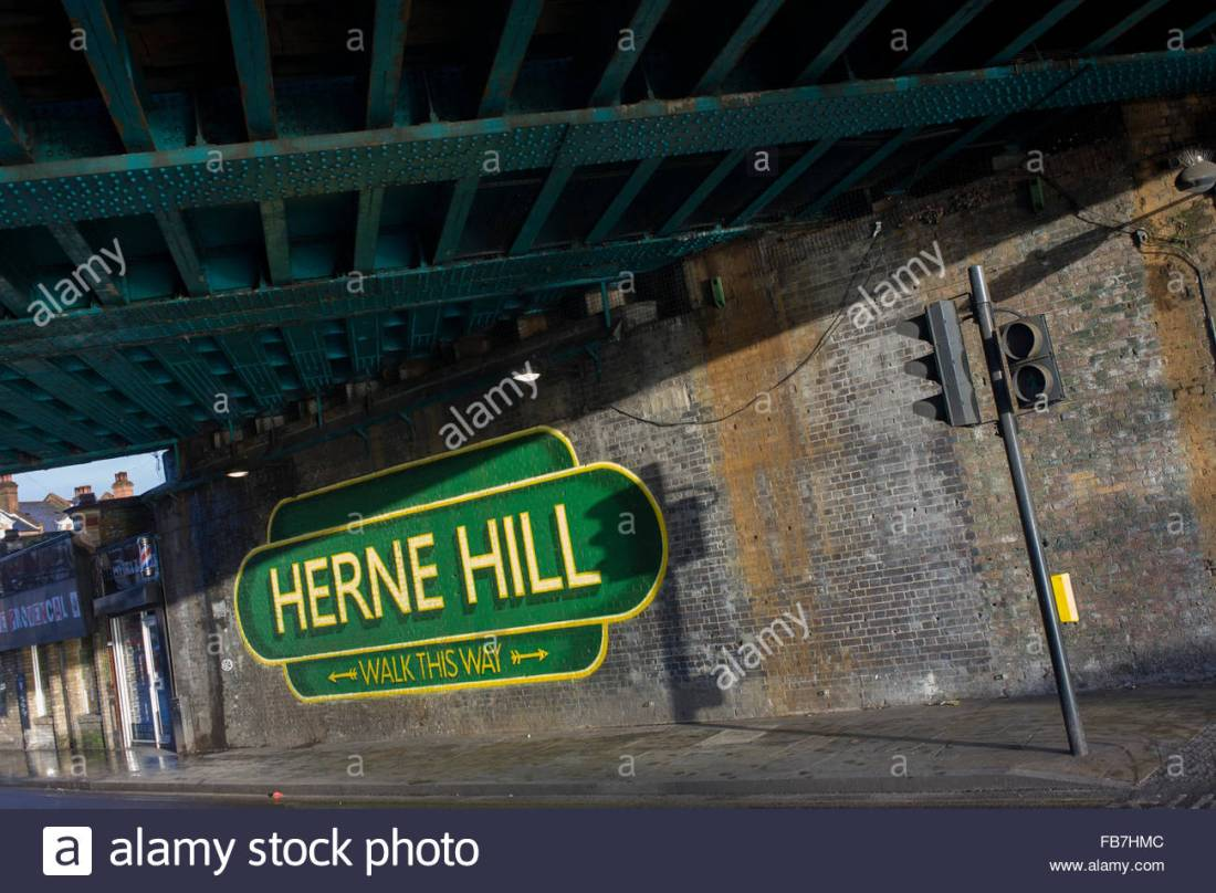 old-railway-style-sign-under-railway-bridge-in-herne-hill-south-london-FB7HMC