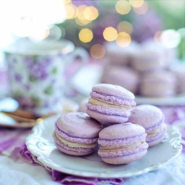 close up photo of macarons on plate